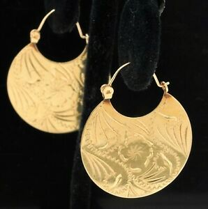 Vintage 14K yellow gold elegant high fashion carved floral disc hoop earrings