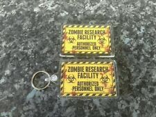 Zombie Research Facility Keyring and Magnet Set. NEW. Horror Memorabilia