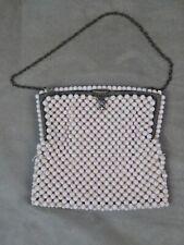 PORTE-MONNAIE à décor de perles. Ancien.