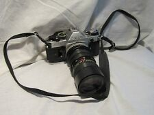 VINTAGE CANON E-1 35 MM CAMERA WITH TELESCOPIC LENS