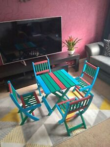 Multicoloured kids folding table and 4 chairs set