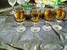 4 60s smoked glasses with gold coffee beans on clear stems [ sambuca ?]