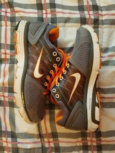 Nike lunar Glade Grey/Orange. size 7.5 women. gently used. excellent condition