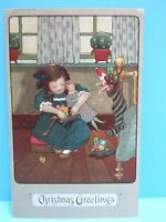 VTG 1900's NOS - EMBOSSED  PC - YOUNG GIRL OPENING GIFTS ON CHRISTMAS GERMANY