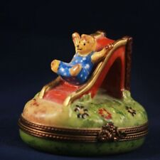 Limoges trinket box, bear going down slide