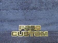 1977-79 FORD TRUCK  F-250 CUSTOM FENDER EMBLEM  NOS FORD  516