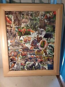 Original collage of animals framed 23 1/2 by 19 1/2 inches