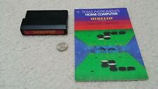 Texas Instruments TI-99 4A computer cartridge and manual, Othello