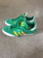 Adidas Samba trainers, green/yellow, size 10, used but in good condition.