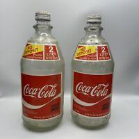 Lot Of 2 Vintage 64oz. Coca Cola no deposit plastic coated glass bottle with cap