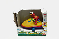 New Damage Box Fisher Price Sesame Street Wind Up Wave Rider Elmo 1998 39474