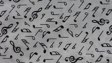 1 metre of polycotton with small black musical notes in various sizes on white