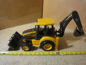New Ray battery operated construction excavator. Volvo tractor backhoe BL71