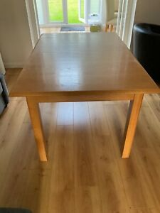Used Marks and Spencer Dinning Table. Brown wood. Extendable.