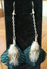 Pretty teal and tan dangling chain silver feathered earrings