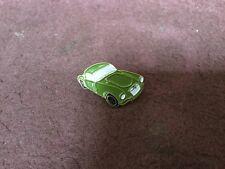 modern motor car pin badge