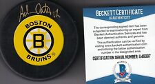 BECKETT ADAM OATES SIGNED VINTAGE BOSTON BRUINS LICENSED LOGO HOCKEY PUCK U49397
