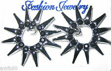 stud earrings with round spiky design and black beads new in silver colour metal