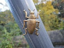 Solid brass beetle garden decoration a tiny magnet attaches to any iron object