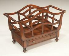 Sheraton style mahogany canterbury with arched top sections and a dra. Lot 127