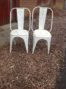 pair of solid metal cafe chairs in good condition