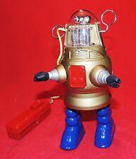 ROBOT PISTON ACTION. Robot en tôle sérigraphiée avec batterie. Superbe boîte.