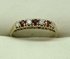 Very Nice 9 carat Gold Red And White Cubic Zirconia Half Eternity Style Ring