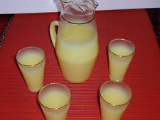 VINTAGE MID  CENTURY YELLOW WATER / TEA PITCHER AND 4 GLASSES