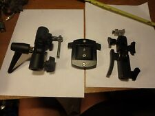 3 camera tripod accessories. left to right- Manfrotto, Bilora and unmarked