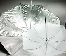 "Four Umbrellas: 2 Black/Silver 44"" Diameter & 2 White/Through 29"" Diameter. Good"