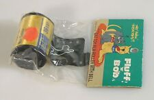 ROLL OF FILM W/ BELL CAT TOY