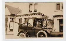 Two photographs of a motor car and driver (C24743)