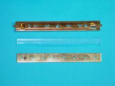 NVA MdI Interimsspange mit Nadel 4-teilig, mit Plasteabdeckung und Halteplatte