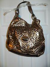 NWT KATHY VAN ZEELAND ANIMAL PRINT PURSE WITH CHARMS.
