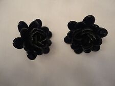 one black, one white and yellow. Two pairs of vintage clip earings,