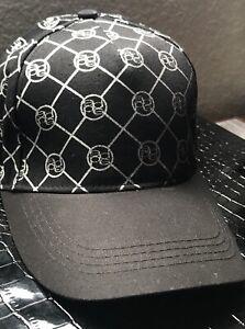bebe BLACK/SILVER CIRCLED LOGO INITIAL ADJUSTABLE BASEBALL CAP LADIES ONE SIZE