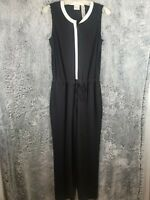 CHICOS BLACK AND WHITE JUMPSUIT WITH DRAWSTRING AND POCKETS. SIZE 0