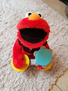 ELMO TOY. MUSIC LETS ROCK
