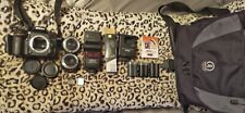 Nikon D7100, 24mm & 50mm prime lens, 3 batteries, speedlight and accessories