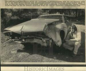 1975 Press Photo James Salamites poses with his damaged car in Meriden