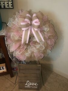 homemade pink with burlap wreath with pink and beige bow