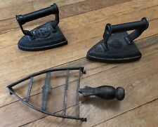 More details for 2 old fashioned cast metal irons. traditional black flat irons and metal trivet