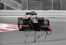 Vitaly Petrov SIGNED 12x8 F1 Lotus-Renault E20 , Canadian GP Montreal  2011