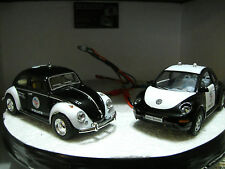 A pair of 1:32 scale VW police cars with Led lights