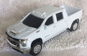 TWO Chevy HD2500 4WD Crew Cab Pickup,one White & One Black 1/64 Scale