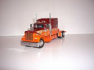 DCP FIRST GEAR 1/64 MAROON AND ORANGE PETERBILT 379 WITH 63'' MID-ROOF SLEEPER