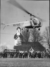 Helicopter lands in front of a large audience - 8x10 photo