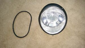 Porsche 930 Headlight Assembly BOSCH H-4 European with Black Rim OEM