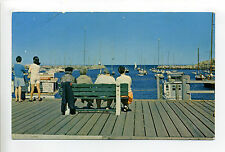 Rockport MA Mass Tuna Wharf, people on bench, retro clothes, boats, 1960's?