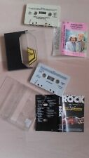 2 Music cassette tapes.